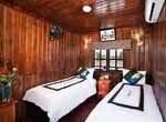 Chambre sur une jonque avec deux lits simples